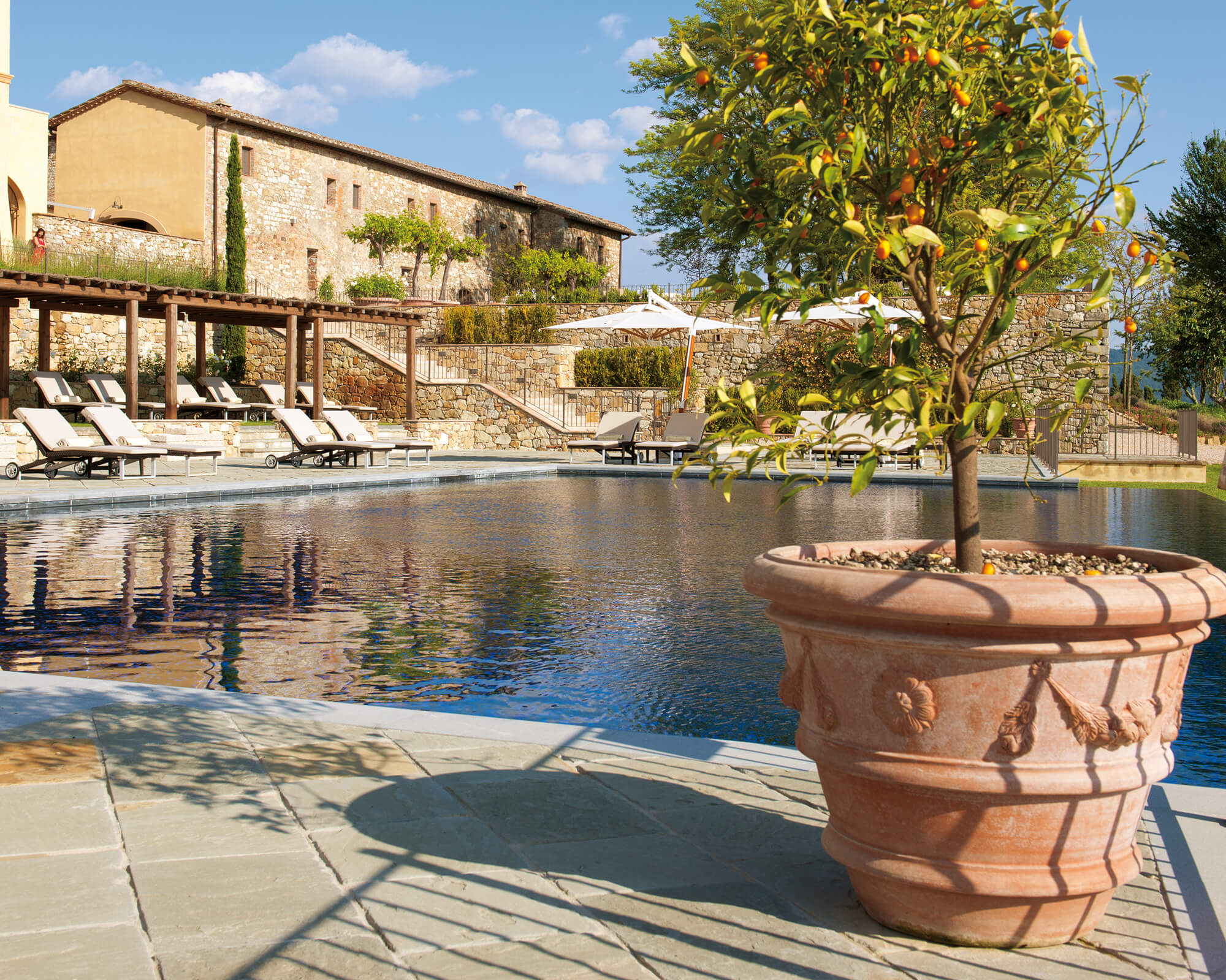 How to Use Terra Cotta Clay Pots in Your Pool Design